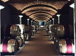 barrels of Amarone inside a cellar